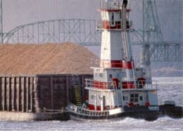 "The 86 foot ""Dauby"" powers chips toward the Hood River Interstate Bridge"